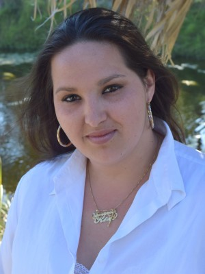 Keri Garcia, Licensed Massage Therapist in Fort Myers, relieves pain, promotes relaxation, and increase range of motion.